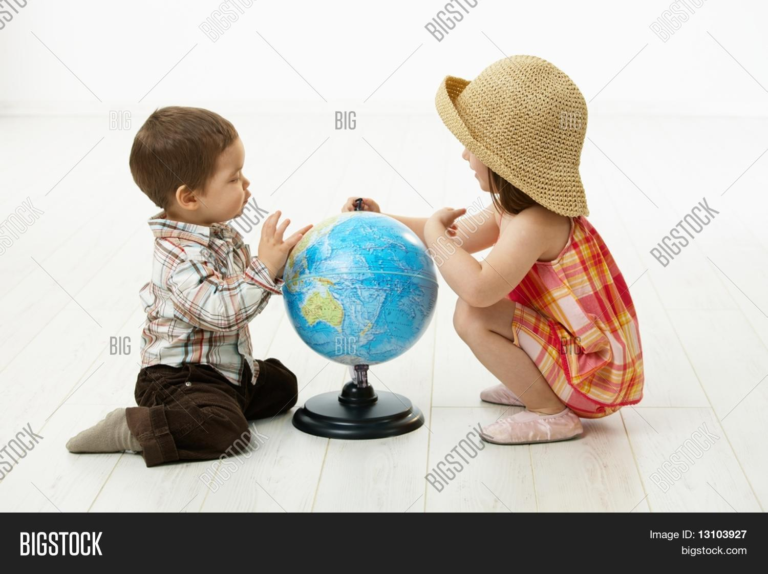 2,2-3,adorable,american,background,boy,brother,brown,caucasian,child,crouching,cute,daughter,enjoy,enjoyment,face,female,five,floor,full,fun,girl,globe,hair,have,horizontal,image,isolated,joy,joyful,joyous,kid,length,little,over,people,people white background,person,photo,playing,siblings,sit,size,stockphoto,toddler,toddlers playing,two,white,years