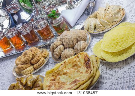 Moroccan tea glasses and biscuit, arabian party stock photo