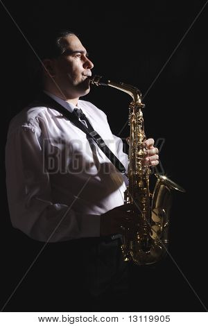 A man playing his wind instrument with expression. stock photo