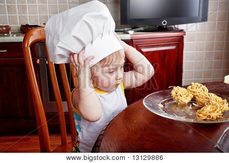 Little cook: fruits and baby food stock photo