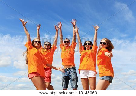 Cheerful young people having fun on a beach. Great summer holidays. stock photo