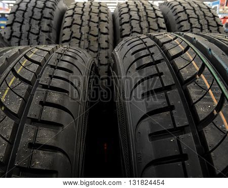 Symmetrical summer tires on the showcase at the tires shop stock photo