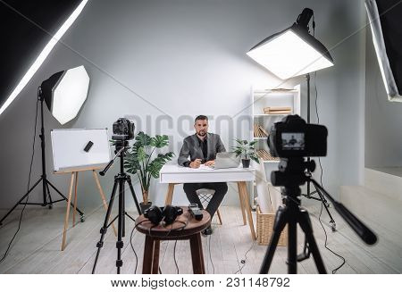 Video footage of the training program from a young business coach. Becxtage from recording a video of a businessperson's lecture. Record a TV program with a young handsome male presenter. stock photo