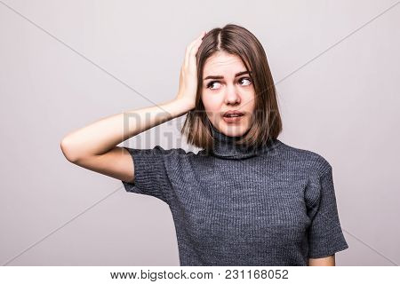 Wrong doing. Closeup portrait upset woman, slapping hand on head having duh moment isolated on gray background. stock photo