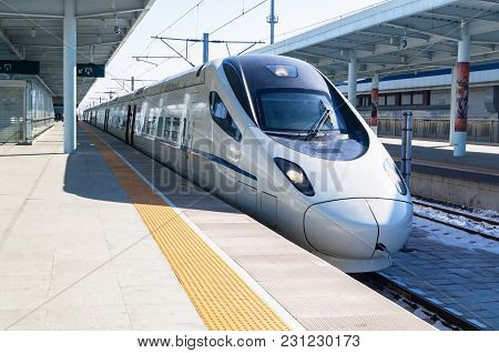 View of a CRH high-speed bullet train at the YANJIXI Railway Station, JILIN, CHINA stock photo