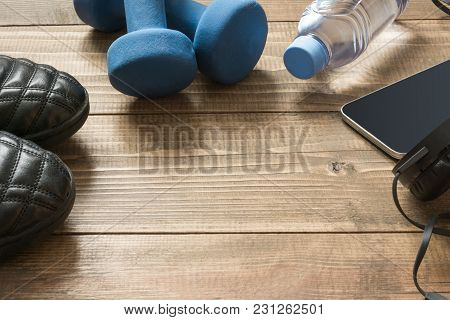Sport and fitness equipment on wooden board. Close up. stock photo