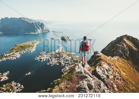 Man Traveler Hiking On Reinebringen Mountain Ridge In Norway Lifestyle Adventure Traveling Outdoor S