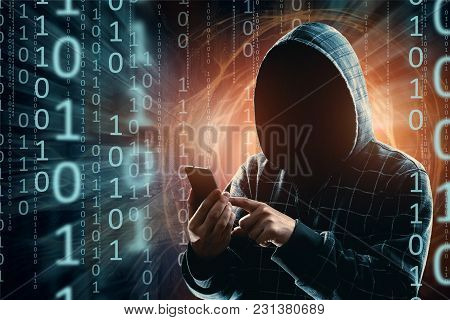 A Young Hacker In A Hood Hacks A Smartphone, A Hacker Attack, A Silhouette Of A Man, Mixed Media. Th