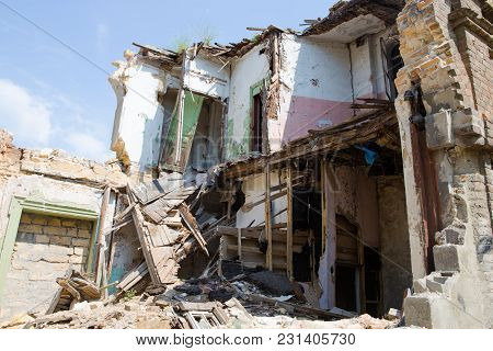 Concept of the fighting force and war. Abandoned and devastated building in Ukraine, Donbass. Ukraine war stock photo