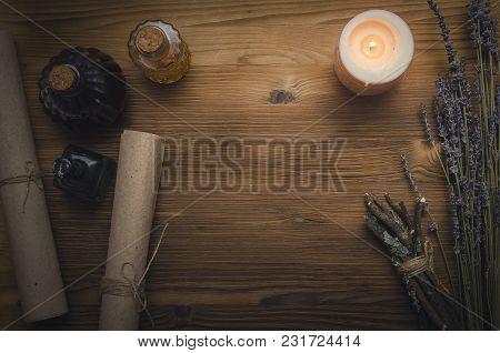 Magic potion. Alternative herbal medicine. Shaman table with copy space. Druidism concept. Witch doctor desk background. stock photo