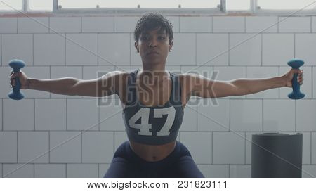 black woman portrait during weight training closeup with foucus on hand with weight moving to a camera stock photo