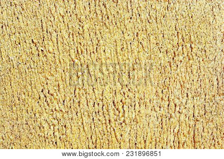 Abstract shiny golden background. Gold coating of porous surface stock photo
