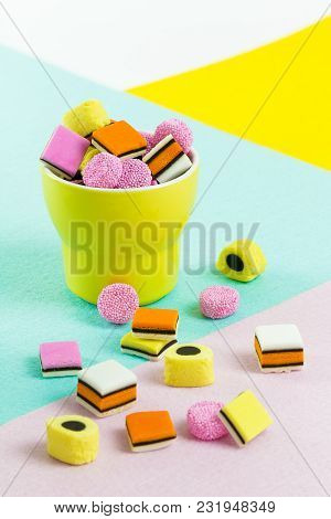 fashion food candy: liquorice allsorts in a yellow cup stock photo