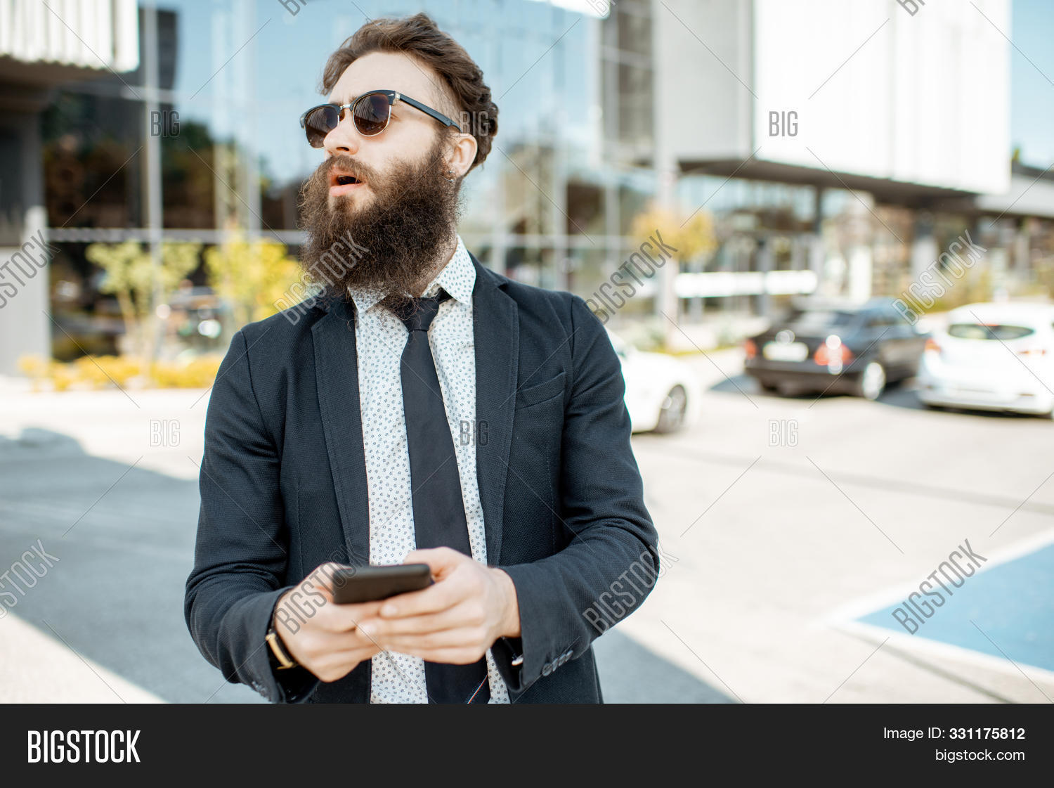 adult,beard,boss,building,business,businessman,businesspeople,caucasian,city,confident,corporate,elegant,exterior,finance,handsome,hipster,male,man,manager,mobile,office,one,outdoor,people,person,phone,portrait,professional,success,successful,suit,sunglasses,talking,tie,urban,work,worker,young