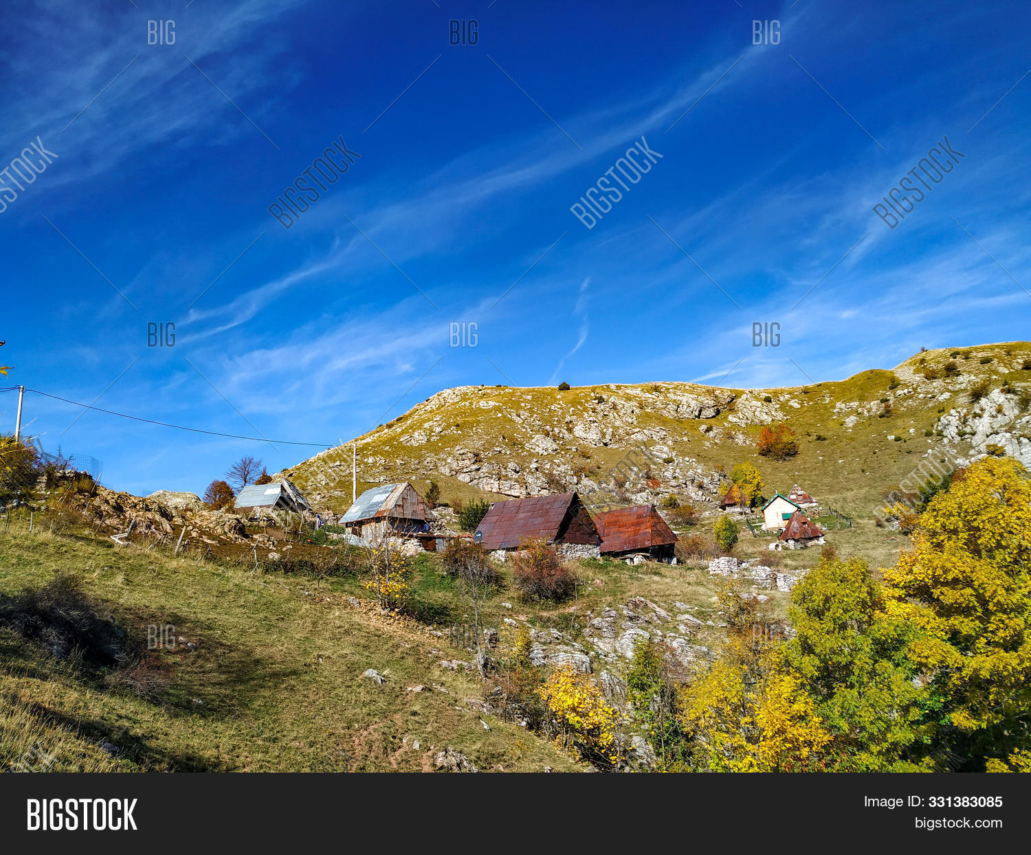 adventure,agriculture,architecture,attraction,autumn,background,beautiful,blue,building,built,cabin,calm,cottage,country,countryside,destination,domestic,environment,fall,farm,farmland,grass,hiking,hill,homes,house,huts,isolated,journey,landscape,meadow,mountain,nature,old,peaceful,rest,rooftops,rural,scenery,sky,traditional,village,weekend