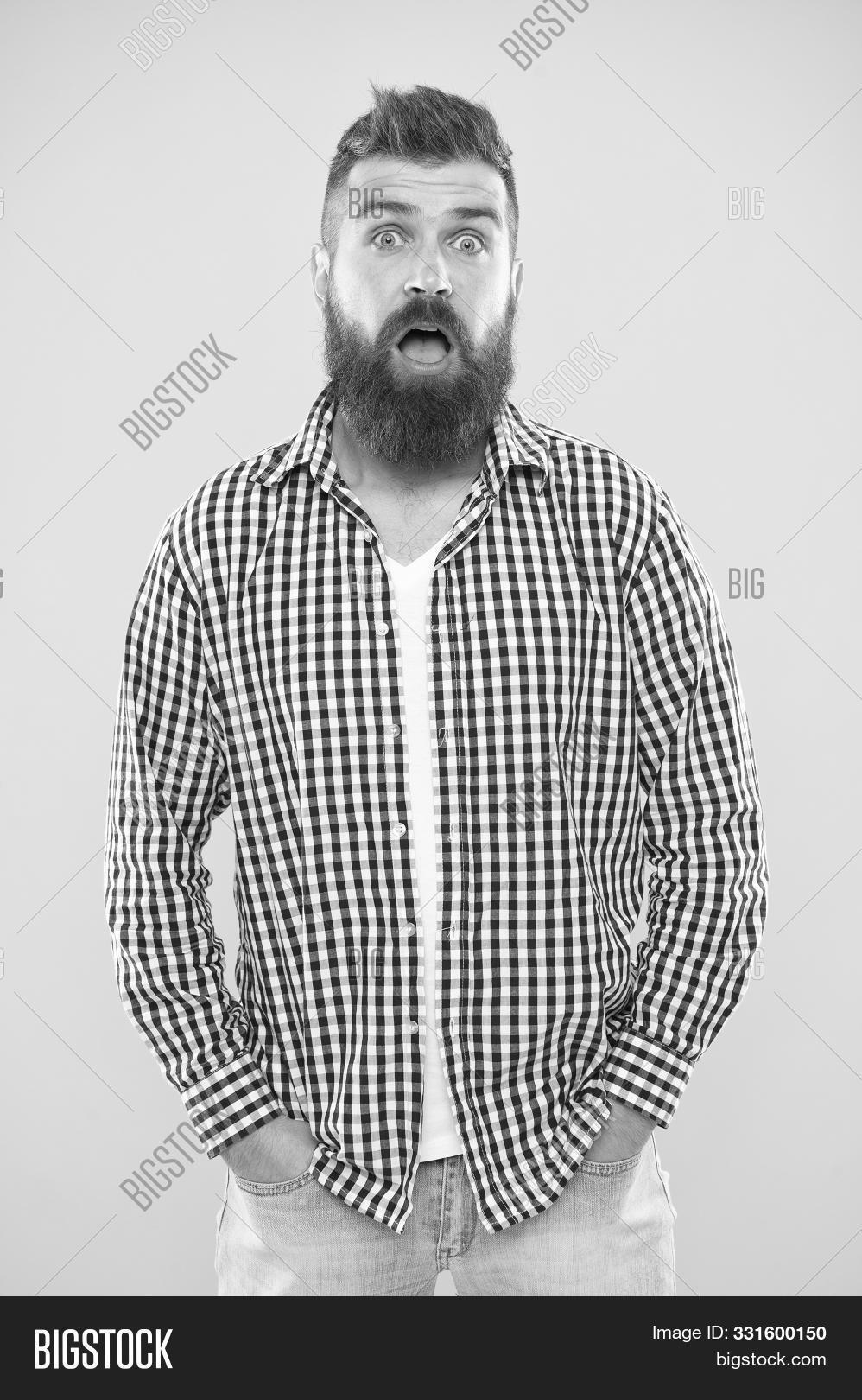 adult,appearance,background,barber,beard,bearded,brutal,care,casual,caucasian,concept,emotional,emotions,expression,face,fashion,fashionable,guy,haircut,hairdresser,handsome,hipster,lumbersexual,macho,maintain,man,masculine,masculinity,mustache,quite,shirt,stand,stylish,surprise,surprised,tips,unexpected,unshaven,wonder,yellow