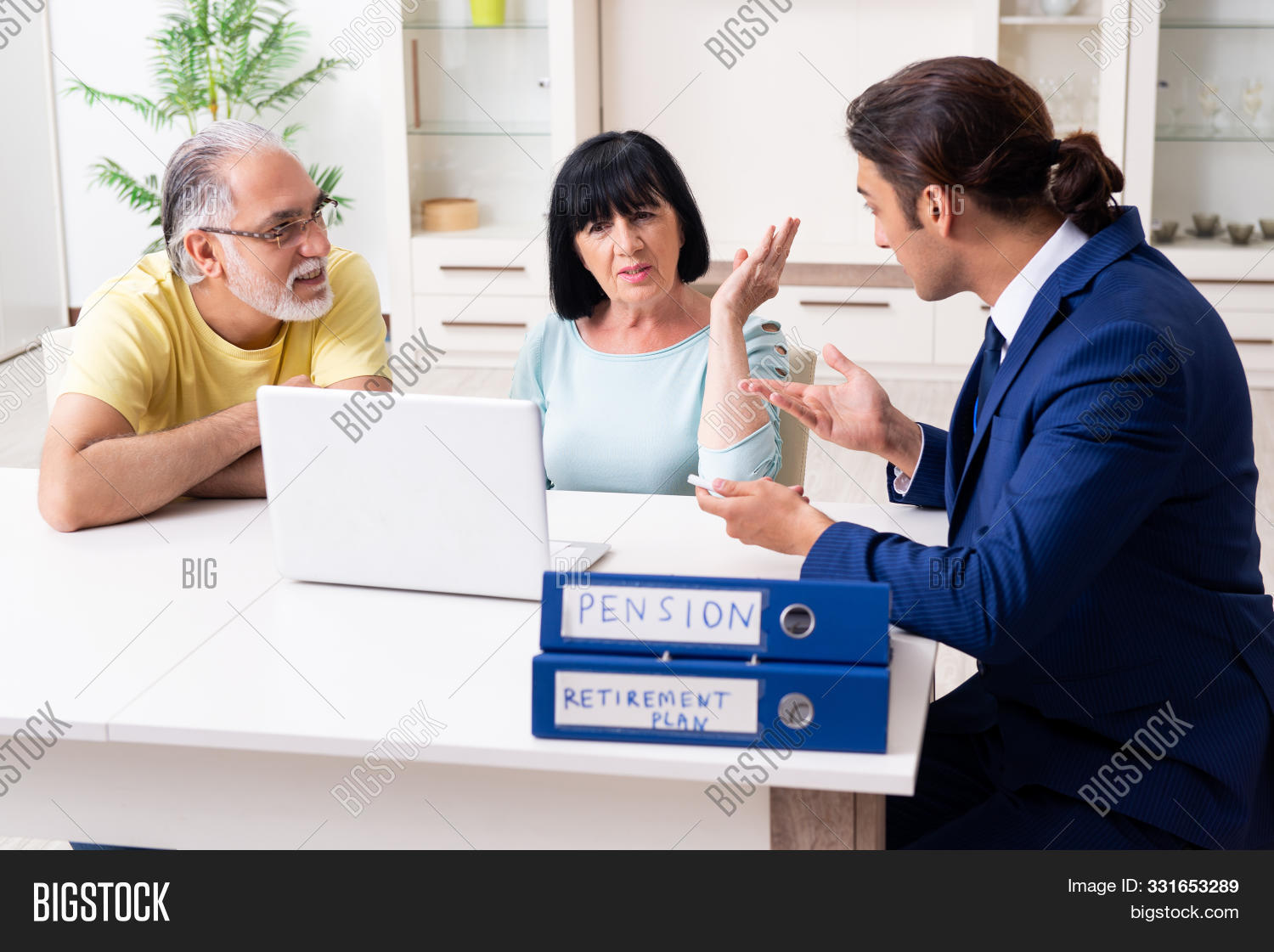 Financial advisor giving retirement advice to old couple