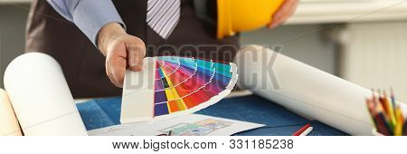 Architect Working on Graphic Design Color Swatch. Sketching Pens, Paper on Engineer Desk. Architectural Drawing with Work Tools and Accessories. Creativity Concept. Print Samples Choice stock photo