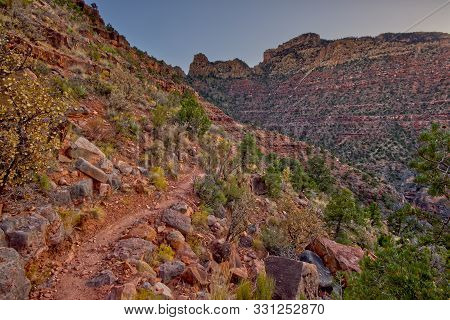 View of the Grandview cliffs on the south rim of the Grand Canyon. The trail on the left is the Grandview Trail leading down from those cliffs. This trail leads from the cliffs above down to the Horseshoe Mesa. stock photo
