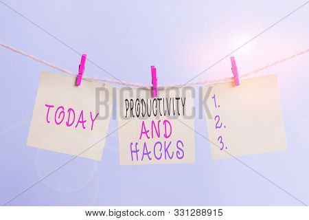 Writing note showing Productivity Hacks. Business photo showcasing tricks that you get more done in the same amount of time Clothesline clothespin rectangle shaped paper reminder white wood desk. stock photo