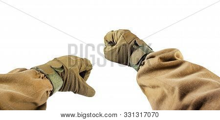 Isolated first person view photo of arm fists in tactical gloves and olive jacket. stock photo