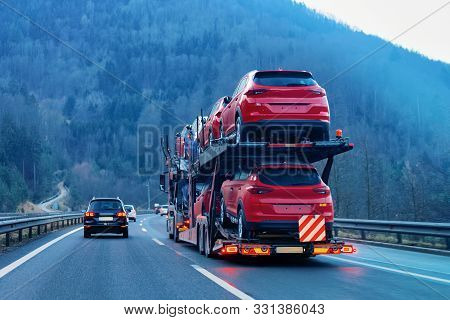 Cars carrier transporter truck on road Auto vehicles stock photo