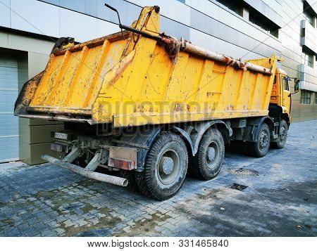 Big yellow truck. Construction equipment. The car for transportation of cargoes, loose substances with the reclining body. stock photo