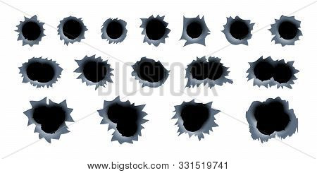 Shotgun gunshot traces of a bullet holes in a metal background. stock photo