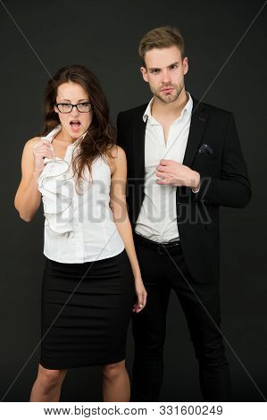 How to attract a boss. Boss man and sensual female coworker in formalwear. Couple of handsome boss and sexy employee. Boss and subordinate on grey background. Business relationship. stock photo