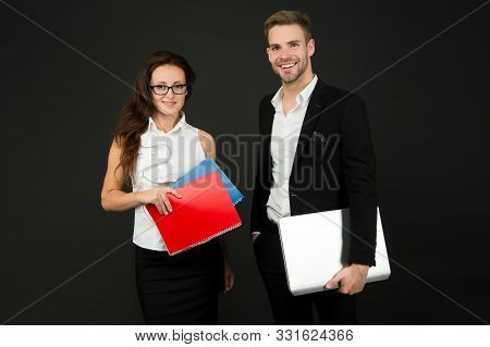 Entrepreneurial relationship. Couple of business partners. Business professionals at work. Sexy woman and handsome man hold business papers. Formal business meeting. stock photo