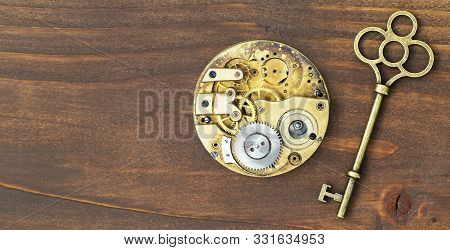 Creative idea, brainstorming concept, web banner of a gold key and clockwork gears stock photo