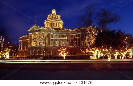 historic courthouse light with christmas lights stock photo