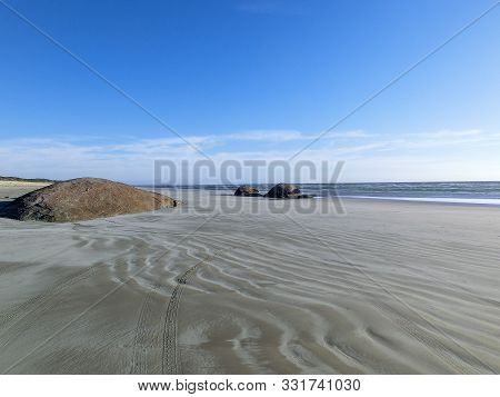 infinity beach with huge rocks in the sand in the Coorong National Park, South Australia stock photo