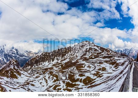Austrian Alps, Grossglocknerstrasse. Dizzy turns of mountain serpentine. Cold cloudy day in the mountains. Snow melts. The concept of active, ecological and photo tourism stock photo