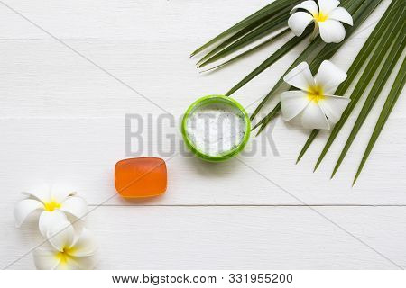 natural herbal coconut scrub health care for surface skin face with herbal soap for cleaner ,coconut leaf ,flowers frangipani arrangement flat lay style on background white stock photo