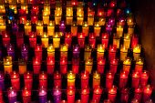 Church candles in red and yellow straightforward crystal fixtures