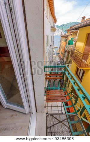 Colorful traditional Italian hotel balcony with view on old town and mountain lake stock photo