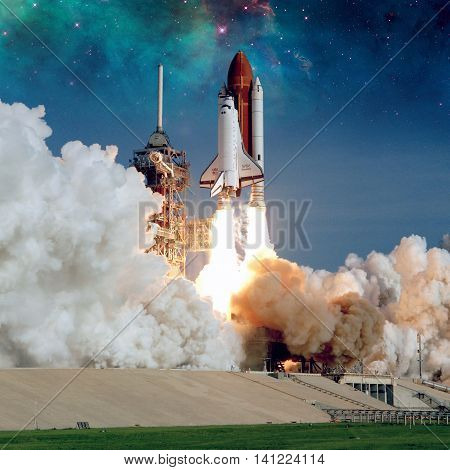 Space Shuttle Discovery launches from NASA Kennedy Space Center Launch Pad. Elements of this image furnished by NASA. stock photo
