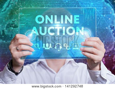Businessman touching a dashboard with key performance indicator displayed with hologram on a virtual screen. Online auction. stock photo