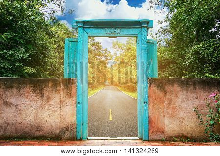 Vintage door with nature background and concept move out of the city to the nature for relax, Journey from the city to the nature for relax, Stop activity and go to nature with freedom of the life.