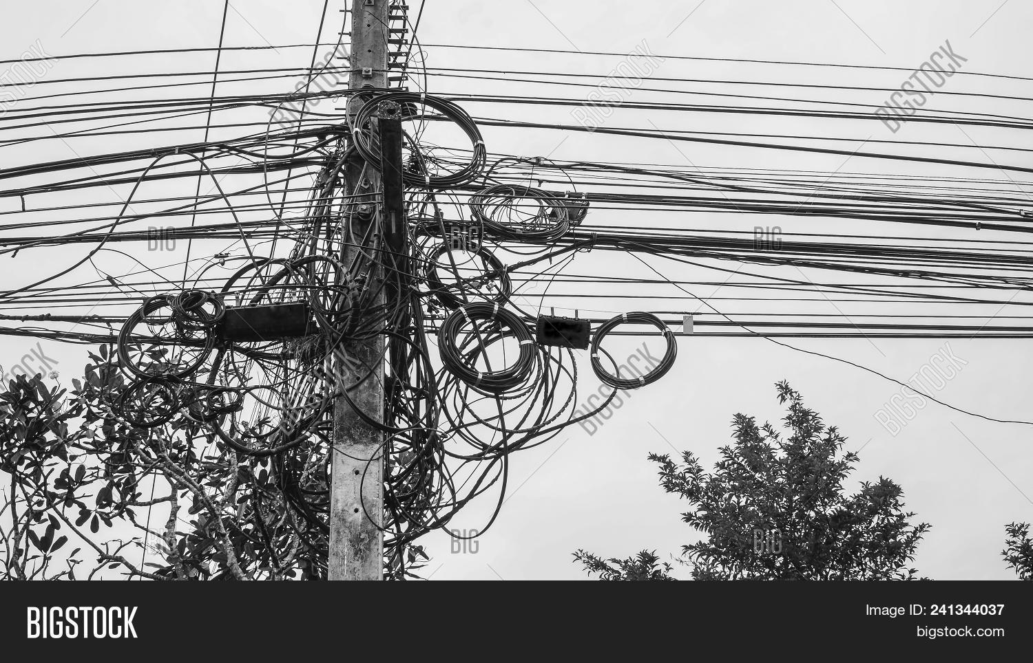 High Voltage Power Pole With Wires Tangled Wire And Cable Clutter Potential Danger From A Mess Of W 241344037 Image Stock Photo