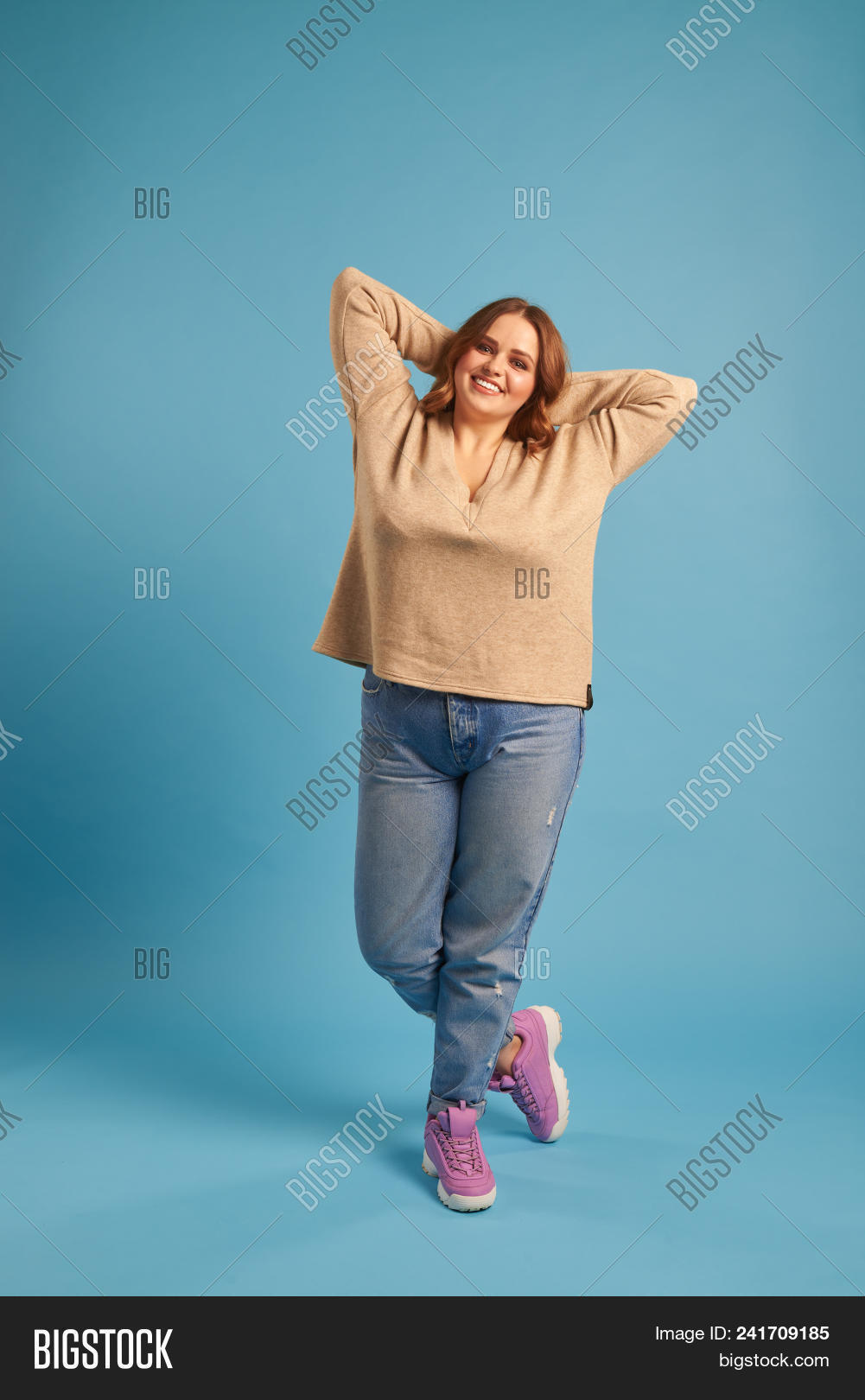 above,adult,alone,attractive,background,beautiful,beauty,big,blue,body,candid,casual,caucasian,clothes,curvy,fashion,fat,female,figure,girl,gorgeous,hair,hands,head,isolated,jeans,joyful,lifestyle,looking,lovely,model,one,overweight,pleasing,plus,plus-size,posing,pretty,size,sneakers,standing,studio,stylish,sweatshirt,voluptuous,wearing,weight,woman,young