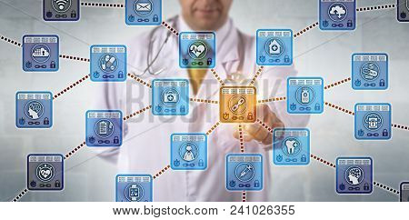 Unrecognizable physician is activating a healthcare blockchain application to access secure medical records. Health care IT concept for data management via distributed public ledger technology. stock photo
