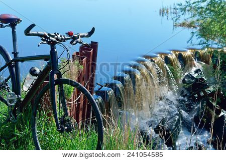 cycling trip, bicycle journey, water aerator, bike places hydraulic structures stock photo