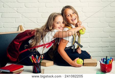 Back to school and home schooling. little girls back to school at knowledge day stock photo