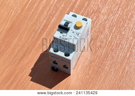 On the table there is an automatic switch of differential current. The device protects human life from electric shock. It combines an automatic switch plus a protective shutdown device. stock photo