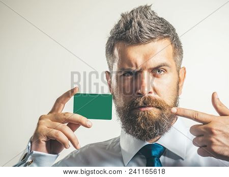 Businessman in a white shirt and blue necktie show credit card or visiting card, closeup. Bank card, creditcard, cash card, business-card - cashless calculation. Copy space for advertise bank. stock photo