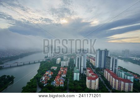 Aerial skyline view of Hanoi cityscape at dawn with low clouds. Linh Dam peninsula, Hoang Mai district. stock photo