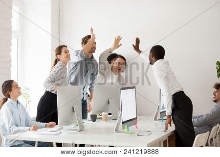 Happy Multi-ethnic Employees Sales Team Giving High Five Together Celebrating Corporate Success And