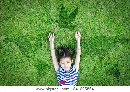 World peace day and International day of peace concept with peaceful mind kid resting in clean natural environment on eco friendly green lawn world map and dove stock photo